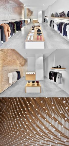 22,000质感木棍装饰的服饰专卖店-瑞士ROK建筑设计师打造-白色的墙壁和水泥地板与墙壁木棒形成强烈的对比