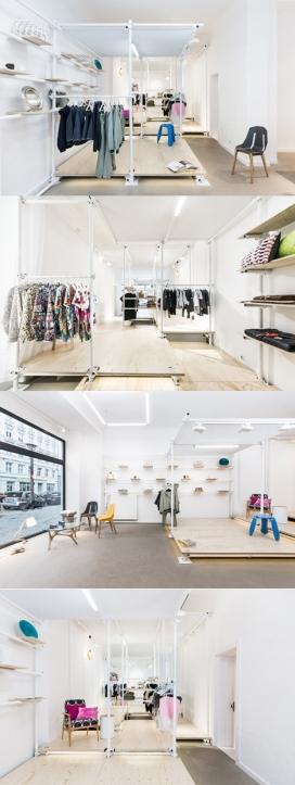 浪漫女屋-专卖店位于德国柏林,漂亮的脚手架形式货架,可移动和重新排列,存储空间被分成两个空间,前面的空间由活动元素组成,如柜台,柜和橱窗布置,可以连接断开,取决于存储的需求。不同高度的胶合板地板梁,创造了一系列的阶梯式平台