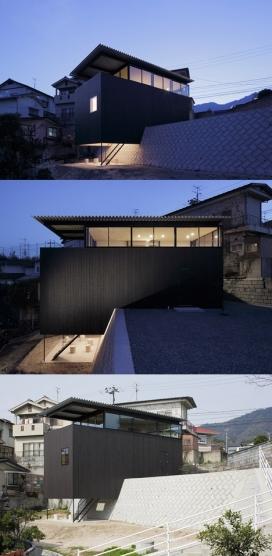 府宅-大野雄的黑木房子-坐落在广岛一个倾斜混凝土悬崖上,采用熏黑的木质,面积达93平方米,有一个四米高的护分开墙,十分适合居住