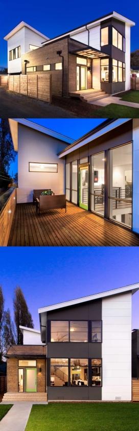 西雅图的家-坐落于离阿尔基海滩几步之遥,三个卧室,两个和一个半浴室,厨房客厅和餐厅都围绕着一个双重高度空间,包括二楼的楼梯和桥梁。