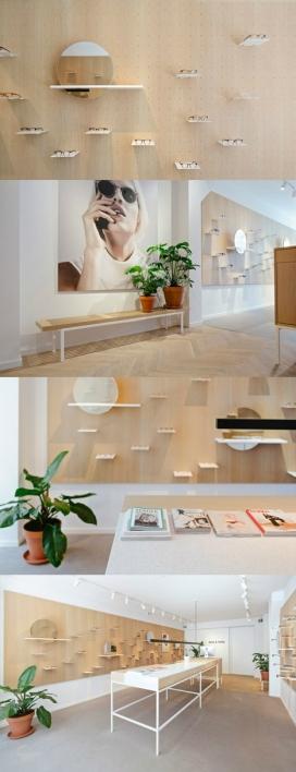"""阿姆斯特丹挂板木线墙壁眼镜旗舰店设计-采用PEG孔安装木板,让显示器和后视镜可以很容易地四处移动,旨在创造一个空间,提供了一个""""独特的零售体验"""""""