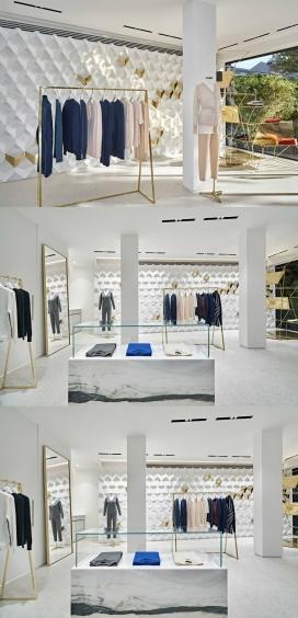 伊斯坦布尔最小的精品羊绒女性服装店-有55平方米,黄铜的几何图案的白色空间,为妇女提供当代的时尚针织服装,干净的切割形状和建筑的线条,唤起鲜明的女性表达的豪华与典雅,令人兴奋的零售空间,让客户体验到精神的艺术旅行,开放式平面图和疏生装饰的衣物架传达一种纯净的空气