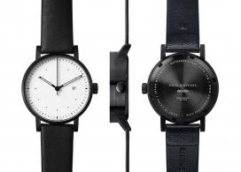与爱立信合作开发的现代简约限量版V03D-Dezeen手表设计。最小的刻度盘的图形,一个黑色的外壳和黑色真皮表带,反映虚空手表和回美感