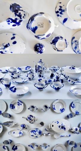 波兰带指纹标记的传统青花瓷餐具设计-生产线上的工人用手指浸入钴蓝盐水中,这样他们的指纹就会印在粘土的表面上,当钴变成深蓝色时,瓷体上出现不规则图案时,刻痕几乎看不见。