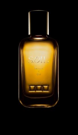 含有光滑黑色和白色的豪华Soil发油-这是一个高端的发油品牌,体现了奢华,同时也提供了一个自然方式来照顾你的头发的方法